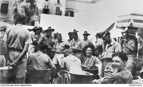 Click image for larger version.  Name:Aust Two up School,  A group of soldiers play a game of two-up at a two-up school in a Hotel yar.JPG Views:2 Size:158.0 KB ID:773733