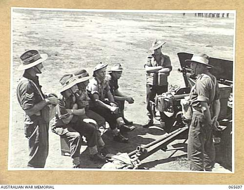 Click image for larger version.  Name:WONDECLA, QLD. 1944 04 05. MEMBERS OF A TANK ATTACK GUN CREW OF THE 2 2ND INFANTRY BATTALION, LI.JPG Views:1 Size:231.0 KB ID:908695
