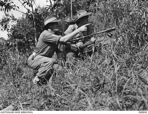 Click image for larger version.  Name:CORPORAL J. F. ARMSTRONG, 2 1 PIONEER BATTALION, (LEFT) INDICATING POSITIONS TO BE ATTACKED BY F.JPG Views:0 Size:247.0 KB ID:913083