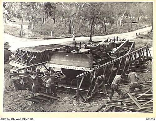 Click image for larger version.  Name:KAIRI, QUEENSLAND. 1944-12-01. 225 FIELD PARK COMPANY, ROYAL AUSTRALIAN ENGINEERS TROOPS ADJUST .JPG Views:4 Size:255.1 KB ID:927571