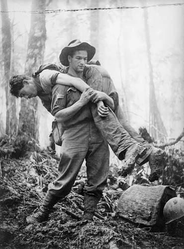 Click image for larger version.  Name:Bull Allen ~ Allen rescuing a soldier off Mt Tambu, 30 July 1943, httpwindsky.com.au. httpwindsk.jpg Views:1 Size:329.2 KB ID:943116