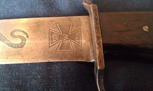 Is this an Authentic trench knife or a reproduction?