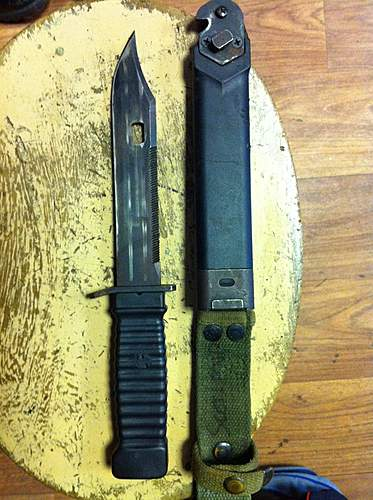 An unknown bayonet and combat knife