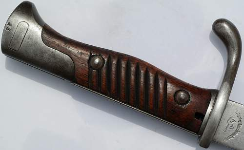 Mauser M1898/05 Sawback butcher bayonet indentification and info needed please.