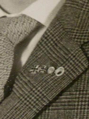 57' awards on civilian clothing.