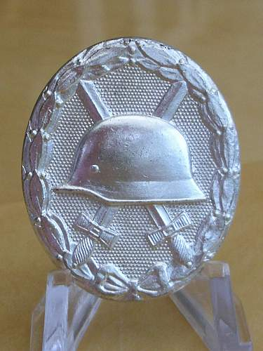 Unusual 57er Wound badge................