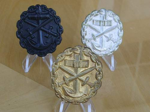 Post war Imperial Naval wound badges...........