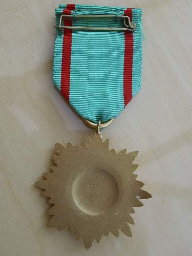 Post war Ostvolkmedaille second class in Gold with swords for bravery