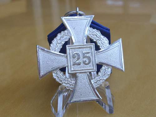 At last ! an early 25 year Faithful Service Cross.