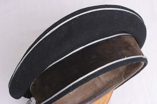 Black SS officer's cap fake: the continuation of junk by other means.
