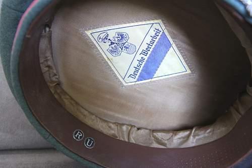 Deutsche wertarbeit label on SS panzer cap probably fake cap?