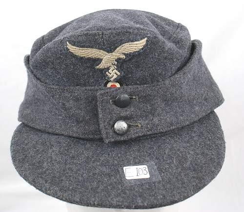 Officer's Kriegsmarine cap, Luftwaffe Einheitsfeldmuetze, and pith helmet