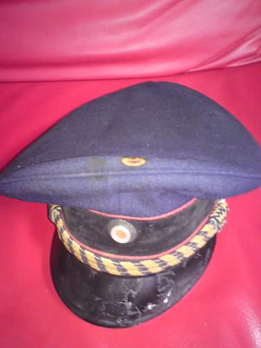Can anybody help me to identify this cap?