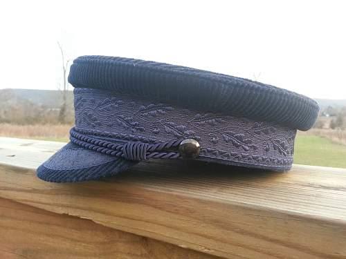 Veterans cap, which i believe is Kriegsmarine Veteran?