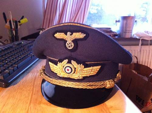 Luftwaffe and Waffen ss cap insignia