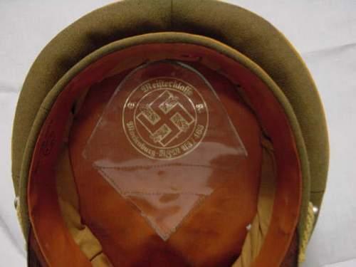 HJ- headgear .Junior leader's visor cap ?