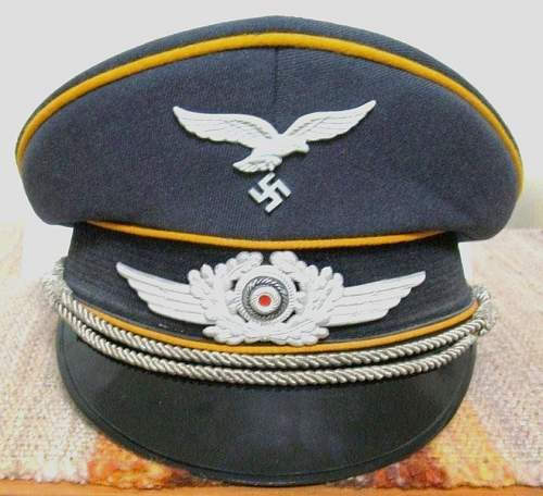 Using an unloved East German cap as a display for WWII Cockade and Eagle?