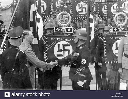 Click image for larger version.  Name:nuremberg-rally-1937-in-nuremberg-germany-adolf-hitler-consecrates-E8PH9X.jpg Views:33 Size:164.0 KB ID:954448