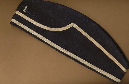 Black  wool ( or felt ) side cap