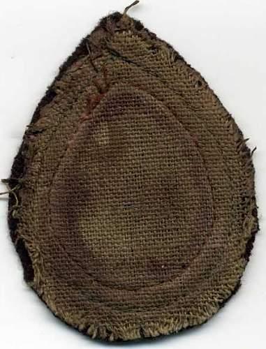 Click image for larger version.  Name:ATS Cloth Teardrop Beret Badge Backng reverse002.jpg Views:112 Size:31.2 KB ID:161355