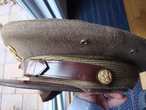 Looking for info on this US Cap & these Garrison Caps