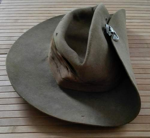 A salty WW2 slouch hat along with Somerset Light Infantry badge. WW2?