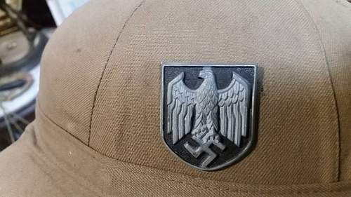 please help me with this german ww2 pith helmet its original or fake????????????please opinions?????????????