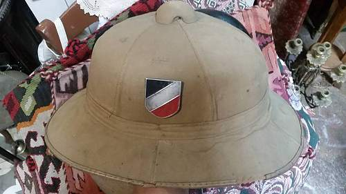 this shields in the german pith helmet its original or fake????????????