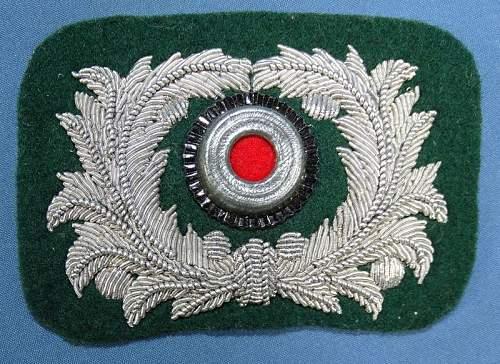 Original Landzoll Officer cap insignia?