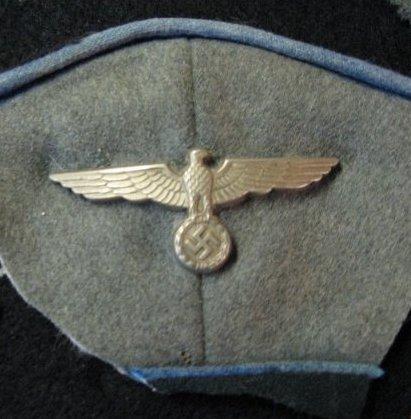 Cut off cap insignia
