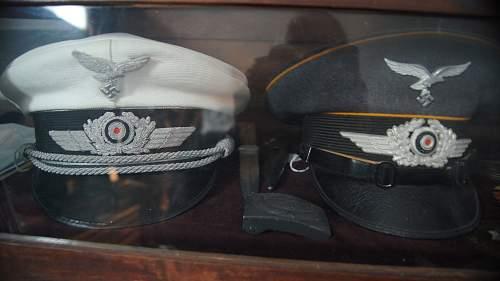 Luftwaffe Summer visor and Flak officer visor, both named.