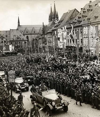 Click image for larger version.  Name:A crowd has gathered in the town square to see Hitler in an open car drives past.jpg Views:39 Size:217.6 KB ID:466722