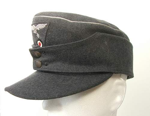 Click image for larger version.  Name:M43 Officer cap trapezoid insignia 002.jpg Views:728 Size:212.2 KB ID:586686