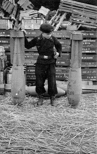 Click image for larger version.  Name:This child soldier is wearing the uniform of Panzer troops. He's measuring himself against aeria.jpg Views:56 Size:193.6 KB ID:602057