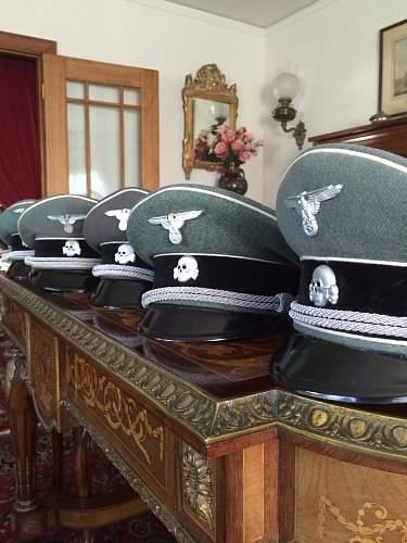 grey SS peaked caps.