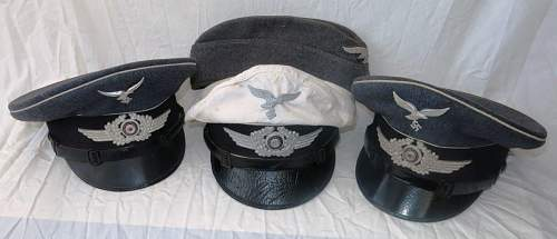 Click image for larger version.  Name:a group of HG Division visor caps 004.jpg Views:12 Size:86.2 KB ID:843271