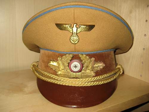 Can anyone identify the maker on this Ortsgruppe visor?