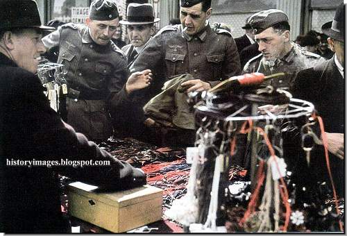 Click image for larger version.  Name:france-paris-german-occupation-german-ww2-german-soldiers-shopping.jpg Views:79 Size:104.5 KB ID:891725