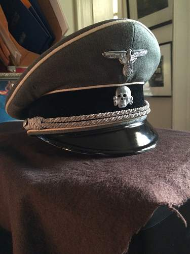 grey SS officer's cap, before and after