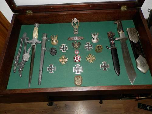 my small collection bayonets,daggers,badges,insignia 1842-1955