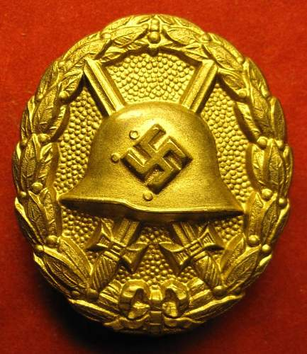 Click image for larger version.  Name:052 Wound Badge in Gold Legion Condor type 1.jpg Views:808 Size:102.5 KB ID:176535