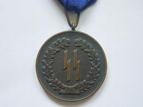 Click image for larger version.  Name:SS Four year service medal 001.jpg Views:55 Size:137.7 KB ID:260549