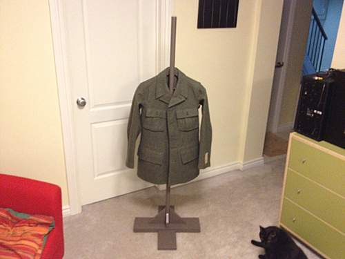 Homemade tunic and helmet display/stand.