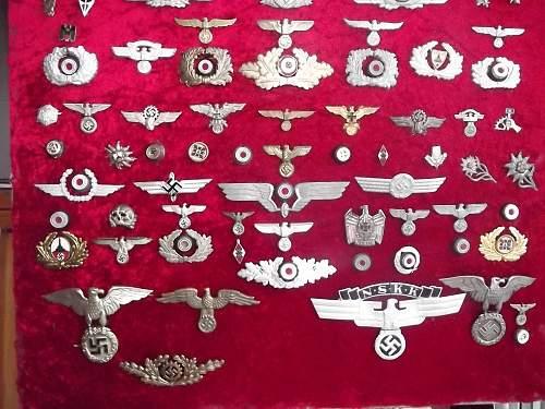 Third Reich head gear insignia very varied