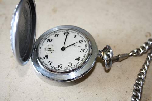 wehrmacht officer clock and pictures
