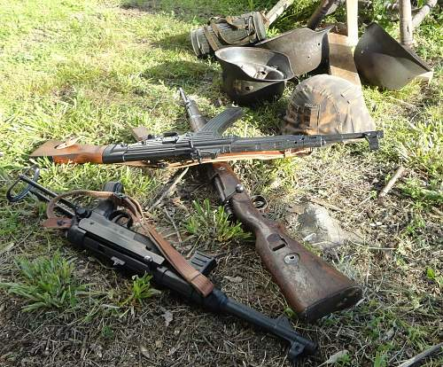 Discarded German Weapons And Helmets