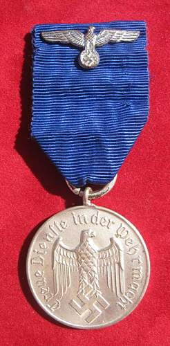 Click image for larger version.  Name:040 Army 4 years Service Medal.jpg Views:323 Size:65.5 KB ID:93881