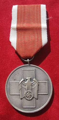 Click image for larger version.  Name:086 Social Welfare Medal.jpg Views:249 Size:56.8 KB ID:93957
