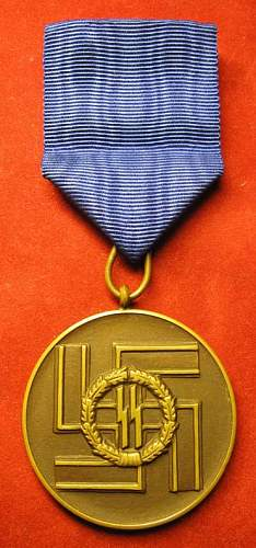 Click image for larger version.  Name:078 SS 8 year Long Service Medal.jpg Views:221 Size:63.9 KB ID:94131