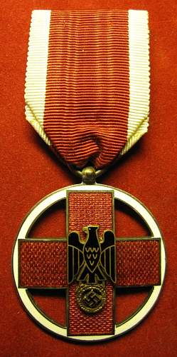Click image for larger version.  Name:084 German Red Cross Medal 1937-1939.jpg Views:161 Size:222.1 KB ID:94556